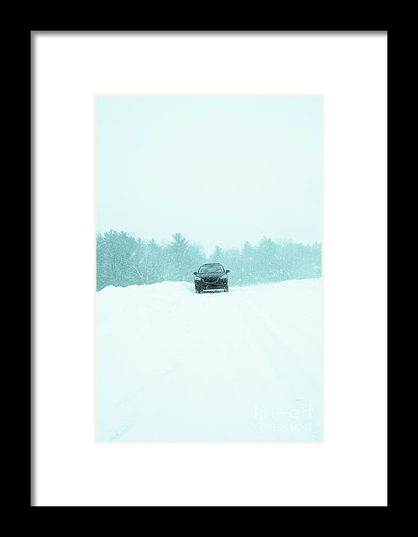 http://fineartamerica.com/featured/car-in-a-snow-storm-edward-fielding.html