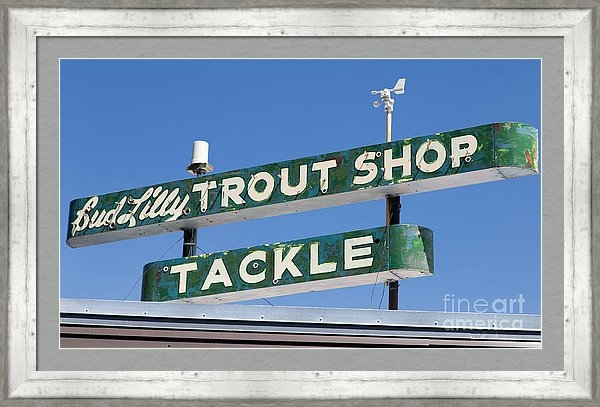 Vintage trout shop sign in West Yellowstone, Montana.