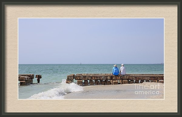 "Edward Fielding sold a 12.000"" x 6.750"" print of Couple Sitting On An Old Jetty Siesta Key Beach Florida to a buyer from Phoenix, AZ."