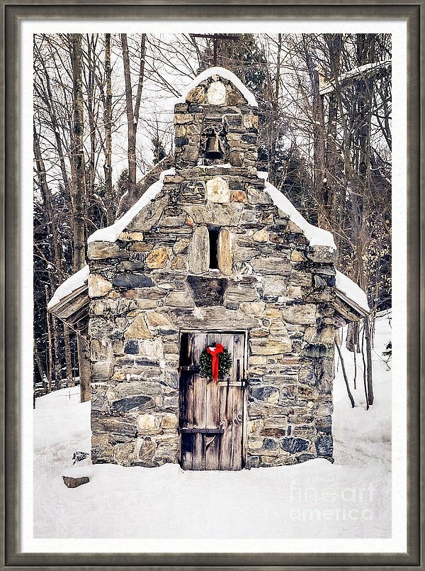 Framed print of an old stone chapel in the snow